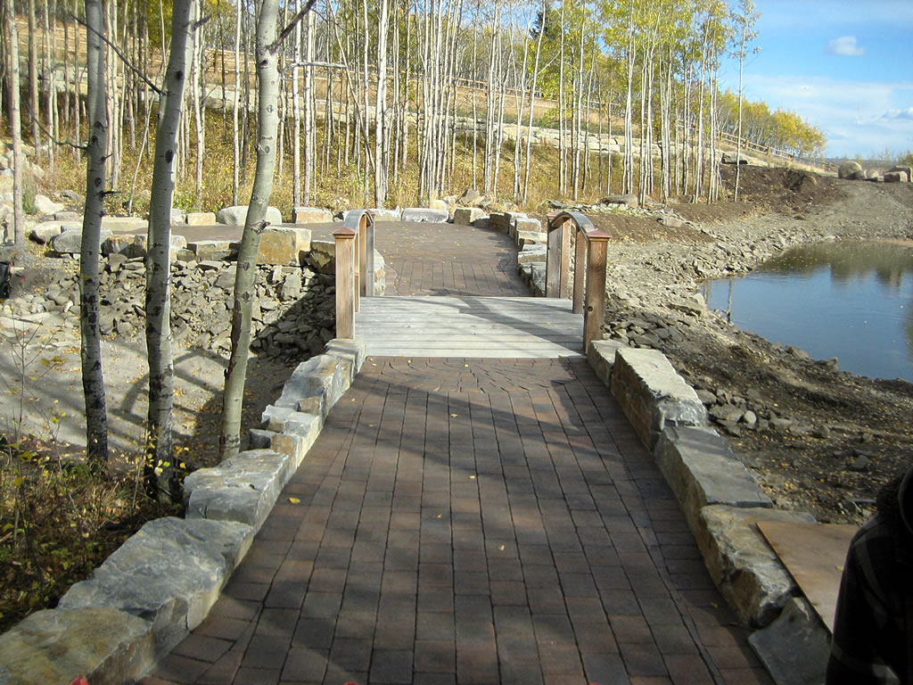 Acreage Patio with Bridge Over Pond