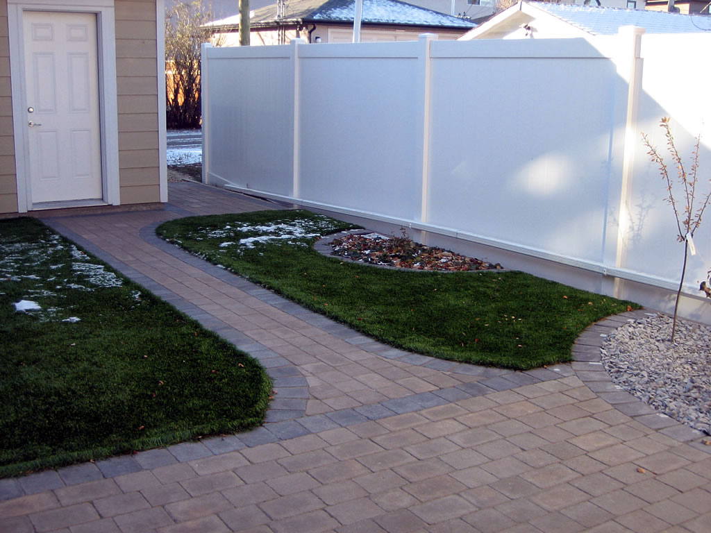 Maintenance Free Yard With Artificial Turf And Brick Patio