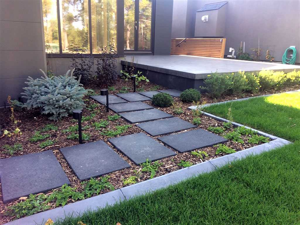 Modern Planting With Slabs And Landscape Lights