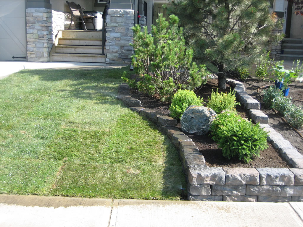 Natural stone flower bed walling morgan k landscapes for Landscaping flower beds with stones
