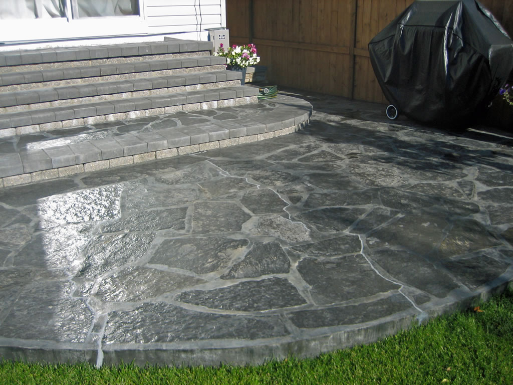 Rundle stone patio with charcoal grout morgan k landscapes for Pictures of stone patios